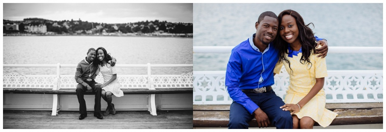 couple sat on torquay pier for couples photoshoot on their anniversary