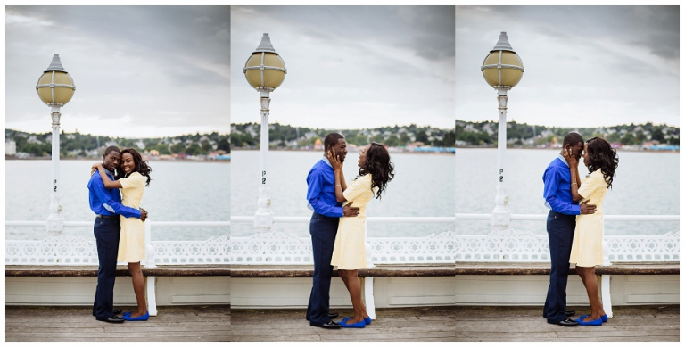 couple embracing on torquay pier on their anniversary