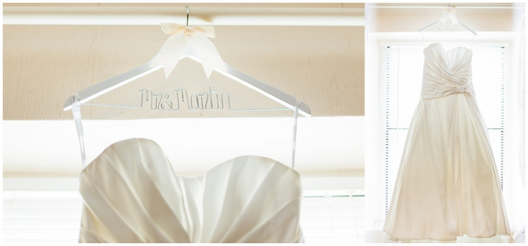 weddng dress hanging in window on personalised hanger