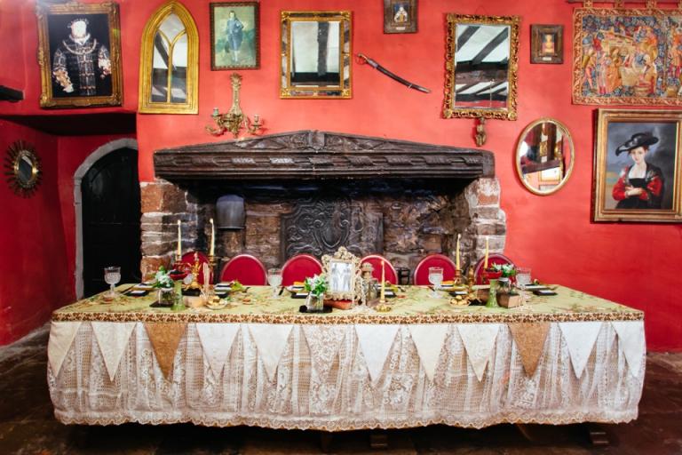 1 Alternative, Gothic Styled Wedding Photography at Churston Court, Brixham, Devon_Dark Romantic top table dressing, portraits, mirrors, red wall