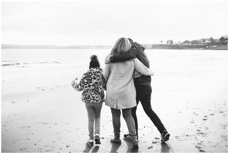 Torre Abbey Sands Torquay Family Photography_black and white family walking along beach
