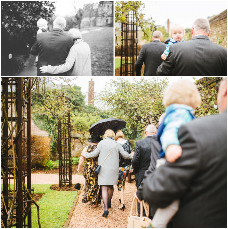 2 Small Intimate Cockington Court Wedding Photography in Torquay - guests walking to ceremony in the rain