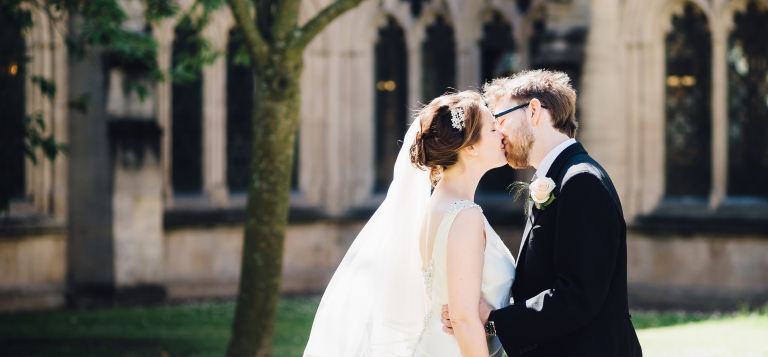 1 Documentary Wedding Photography in Torquay, Exeter, Devon - Kissing outside Exeter Cathedral
