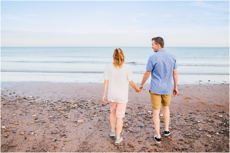 1 Dawlish Warren Engagement Couple Photography in Devon - couple walking holding hands on beach