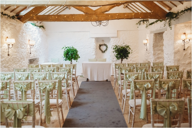 Devon Wedding Photography at Bickley Mill Inn Elegant and Verdant Wedding (1) ceremony room set up by wild floral designs