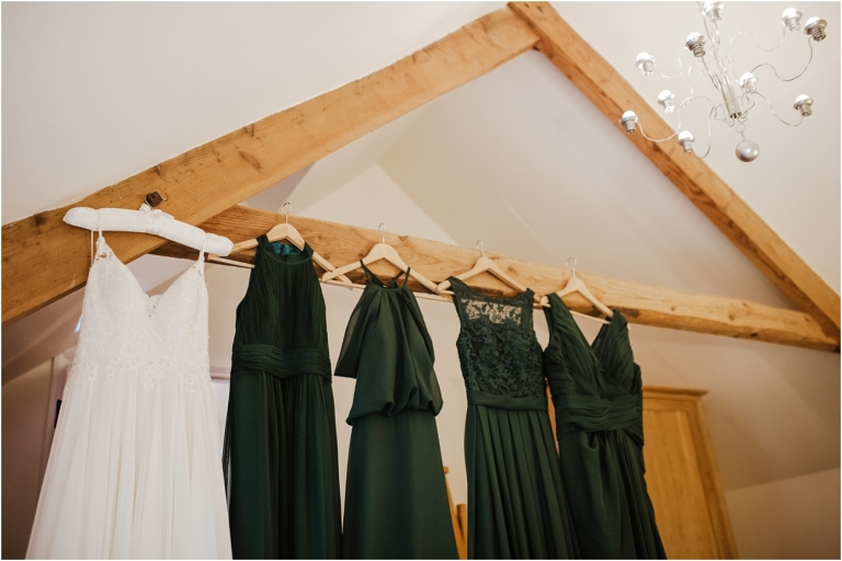 North Devon Wedding Photography at The Milky Way Relaxed Fun DIY Style (1) dresses hanging up