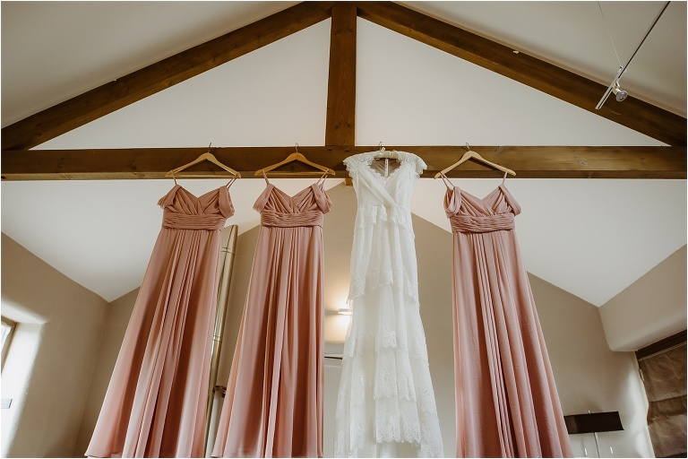 Cornwall Wedding Photography at Trevenna Barns Relaxed Rustic Outdoors Celebration (3) dresses hanging up