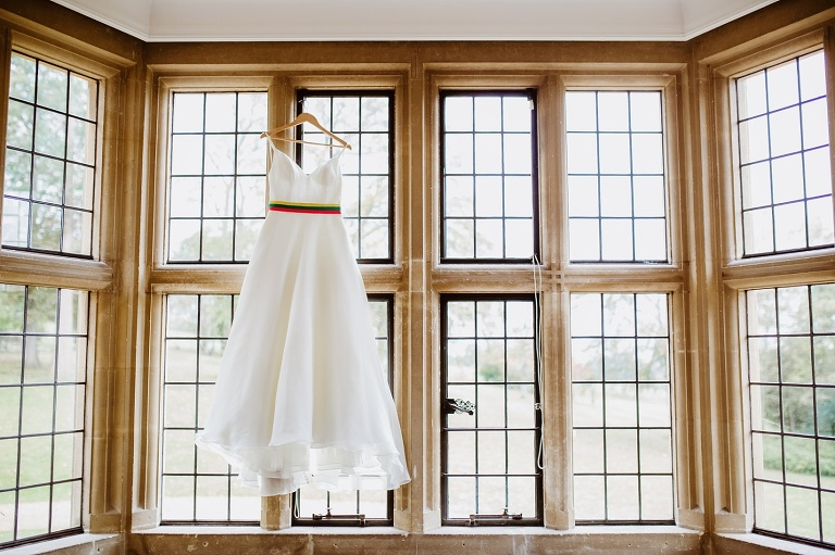 Coombe Lodge Wedding Photography Autumnal Rainbow Styling 2 Dress in window 1